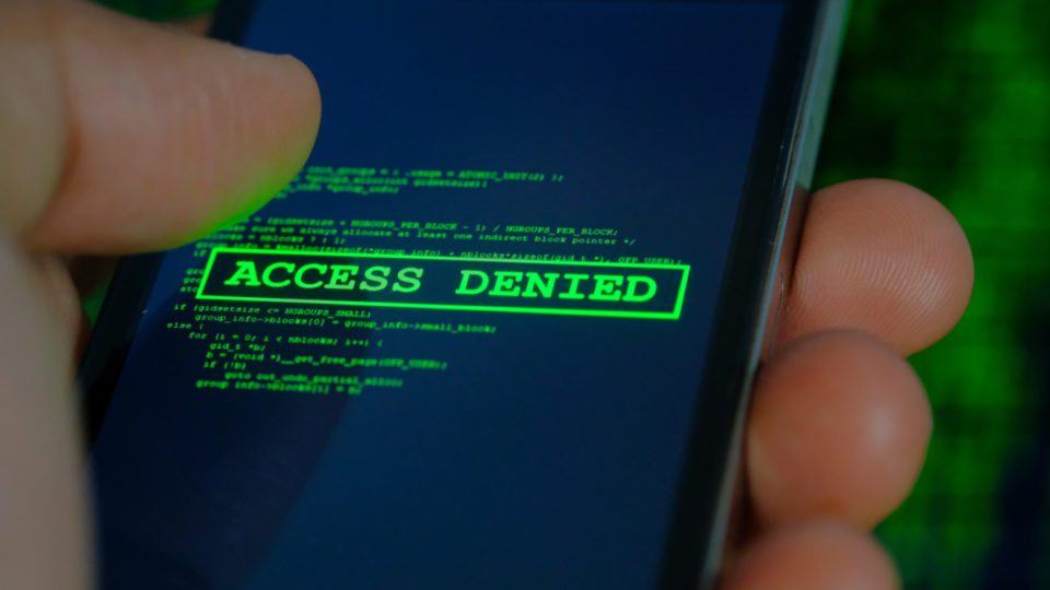 A mobile phone that reads 'access denied'.