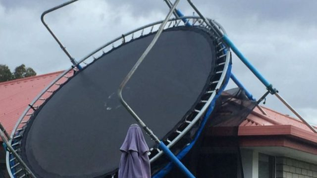 Trampoline tossed through roof in wild Tasmanian winds