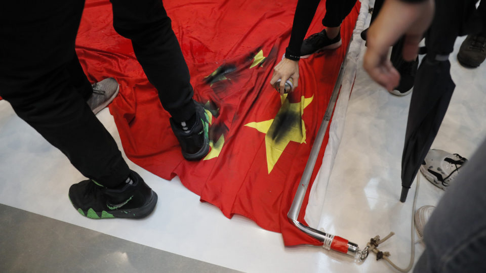 Chinese flag getting trampled by protestors.