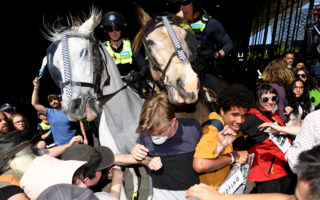 pay police protesters dutton