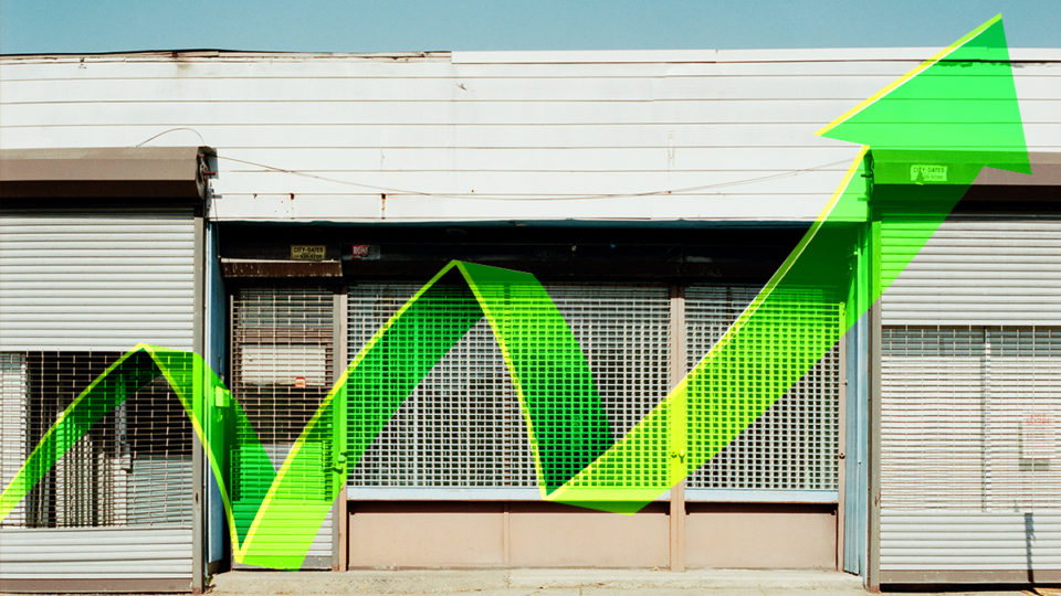 A closed storefront with positive economic data.