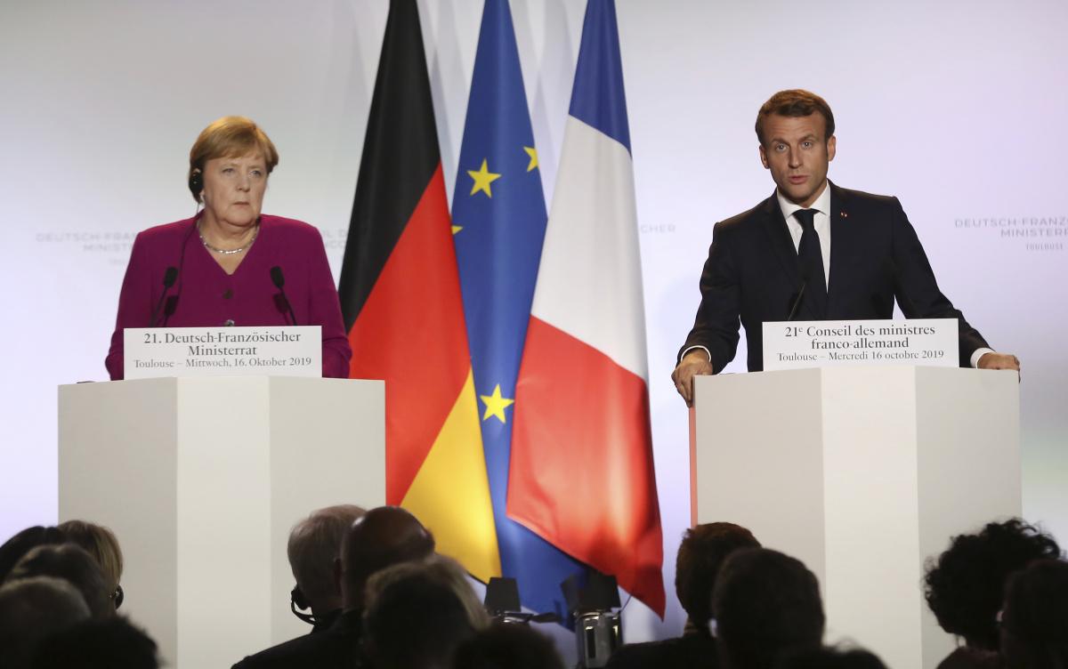 German Chancellor Angela Merkel and French President Emmanuel Macron. <em>Photo: AAP</em>