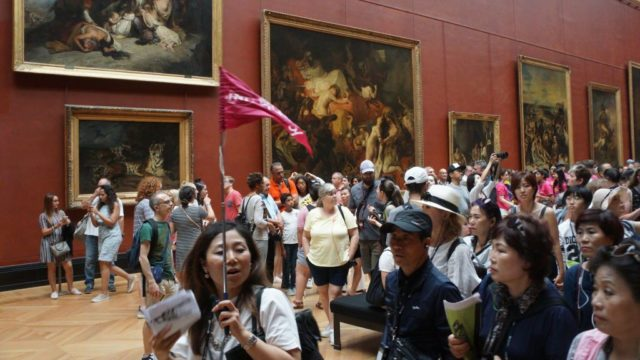 Chinese tourists among the crowds at the Louvre in Paris.