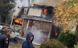 pilot dies plane crash house