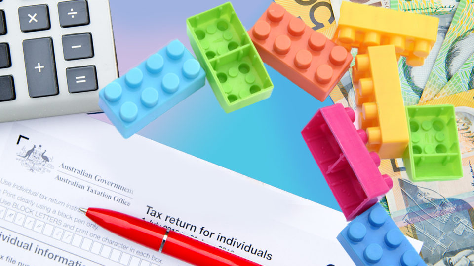 Lego blocks on tax return forms.
