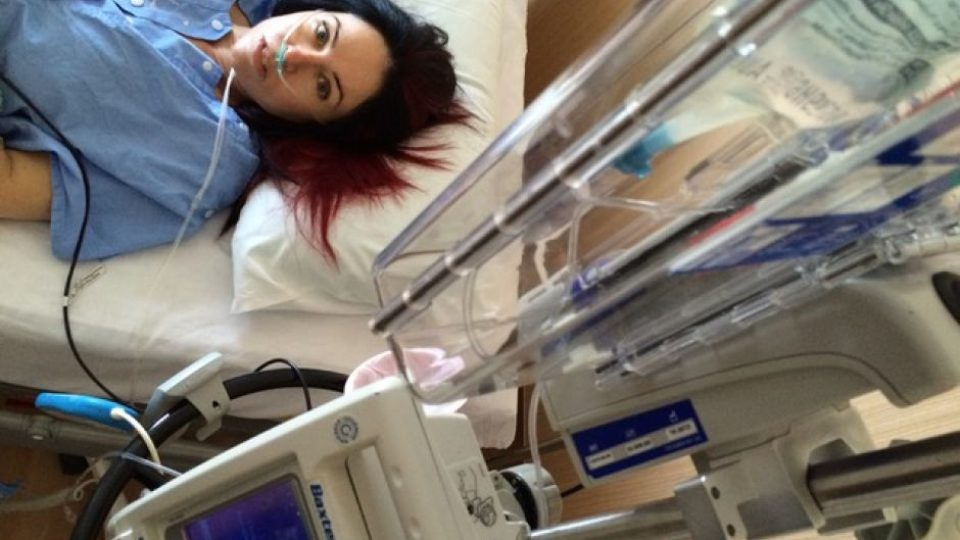 Emma Jane lies in a hospital bed.