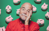 Old retiree man relieved with piggy banks.