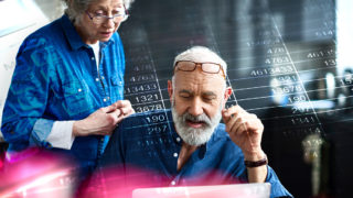 Old people in front of calculations