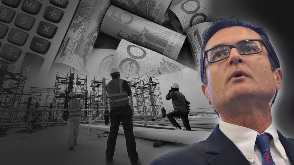 Greg Combet in front of asome workers and money.