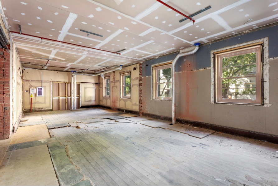 An empty ground-floor apartment in the Gatwick Hotel.