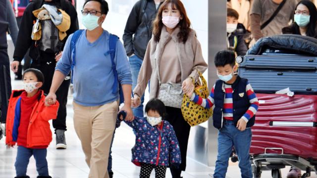 Hunt to track down China flight's passengers as confirmed coronavirus cases grow