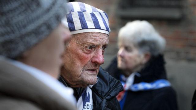 Auschwitz survivors return to death camp, to warn of world's rising anti-Semitism