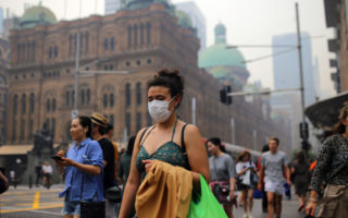 A young woman in Melbourne wearing a face mask