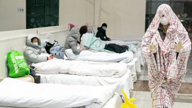 'Wartime conditions': China rounds up virus patients for mass quarantine