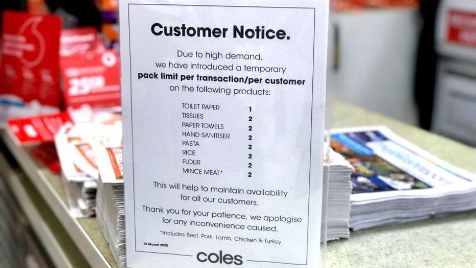 A message to customers at a Coles supermarket limiting purchases of some products.