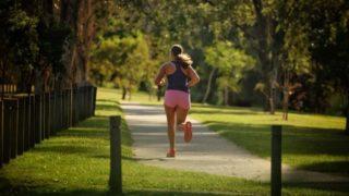 A woman runs along a track in Brisbane