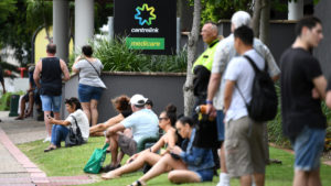People are seen in long queues outside the Centrelink office in Southport on the Gold Coast, Monday, March 23, 2020. Centrelink offices around Australia have been inundated with people attempting to register for JobSeeker.
