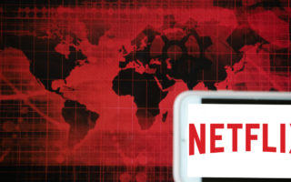 A stock image of a world map superimposed with the Netflix logo.
