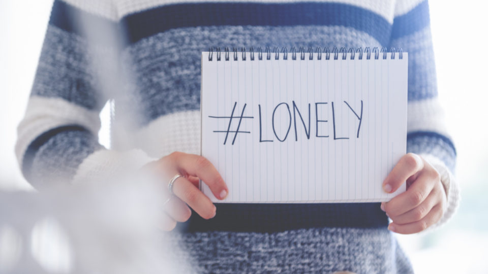 Woman holding a #lonely sign. This is to illustrate the loneliness of the Coronavirus stay at home order.