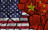Trade war between United states of america VS China . flag on cracked wall background . Confliction and crisis concept