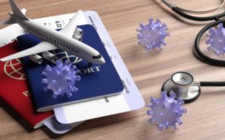 Medical stethoscope and travel documents on wood background