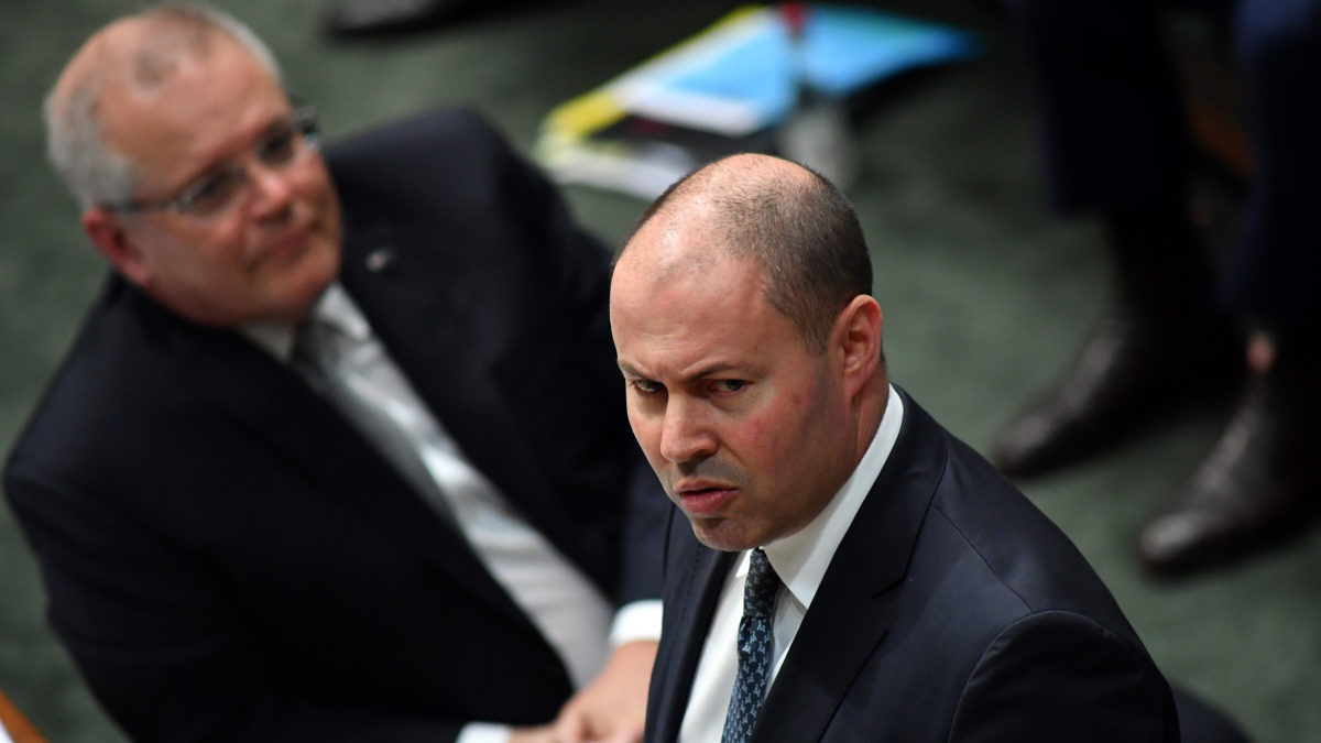 Treasurer Josh Frydenberg (right) reacts alongside Prime Minister Scott Morrison (left) during Question Time in the House of Representatives