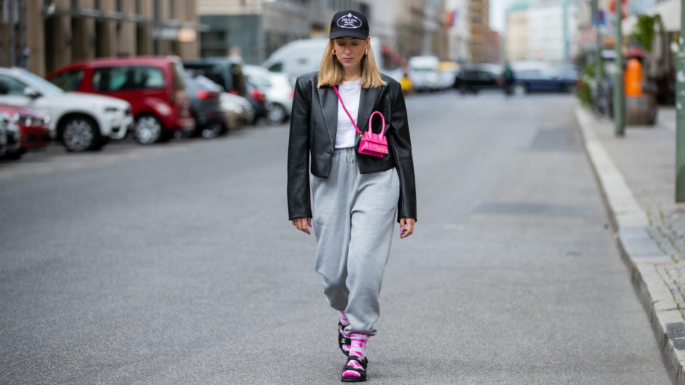 Sonia Lyson is seen wearing pink white socks Weekday, sandals Chanel, grey jogger pants Topshop, tshirt Zara, black cropped blazer Zara, cap Prada, pink mini bag Jacquemus on May 19, 2020 in Berlin, Germany