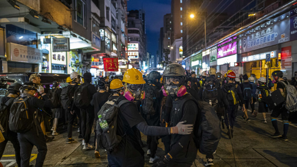 Protesters outside the Mong Kok police station in Hong Kong, Aug. 17, 2019. China is moving to impose new national security laws that would give the Communist Party more authority in Hong Kong, a proposal announced on May 21, 2020. (Lam Yik Fei/The New York Times)