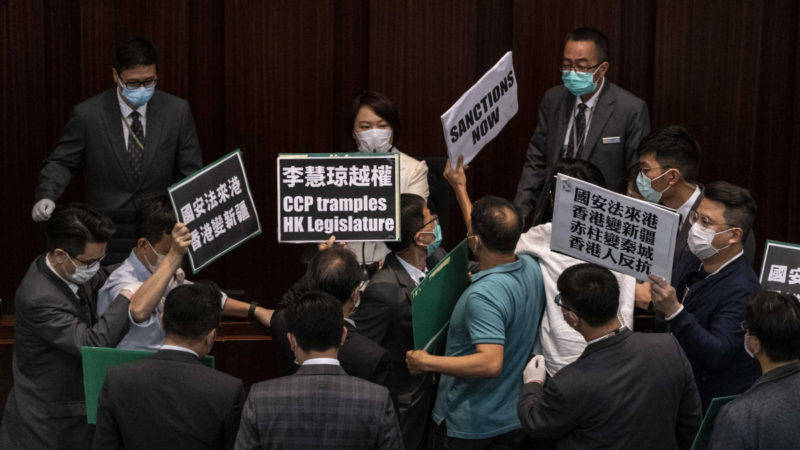 Pro-democracy Hong Kong lawmakers protested against the Chinese government's planned national security laws at a committee meeting in Hong Kong, on Friday, May 22, 2020. Beijing's move to take a direct hand in the territory's affairs will pit the pro-democracy movement against an uncompromising Communist Party. (Lam Yik Fei/The New York Times)