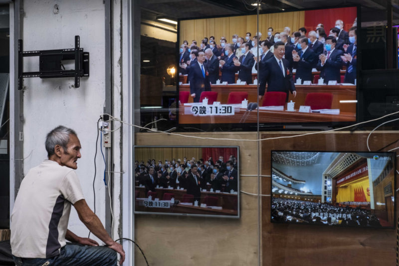 A man watches a TV news program in Hong Kong, Friday, May 22, 2020. Televisions in Hong Kong showed reports about Beijing's plans to impose national security legislation.