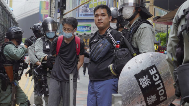 Hong Kong police fire tear gas, make mass arrests as protests resume