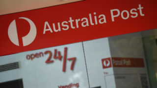 Signage at an Australia Post outlet in Sydney, Wednesday, June 10, 2020. A proposed shake-up of Australia Post deliveries will be opposed by Labor over fears the changes will cost jobs, cut wages and scale back services.