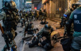 Police restrain protesters in Hong Kong