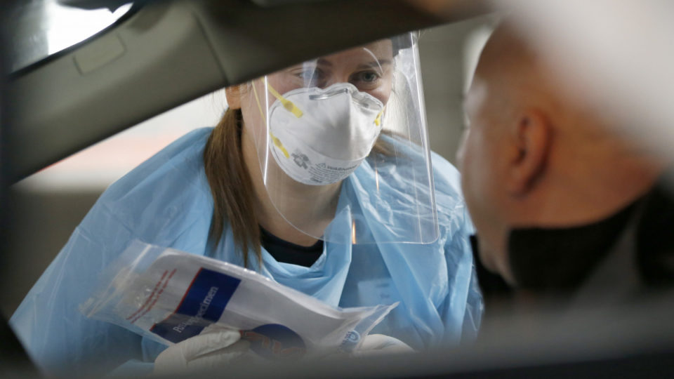 A medical practitioner performs a COVID-19 test on a member of the public at a drive through testing clinic in the carpark of Victoria Gardens Shopping Centre on May 05, 2020 in Melbourne, Australia. The Victorian Government has set up additional COVID-19 testing clinics across Melbourne in a bid to test up to 100,000 people in two weeks. Victorians with even the mildest symptoms are being asked to go get tested, as the state pushes to stop the further spread of coronavirus (COVID-19). Tough restrictions on movement and gatherings remain in place across Victoria despite a decline in the number of confirmed coronavirus cases across Australia. All non-essential businesses remain closed or are restricted in operation, while public gatherings are limited to two people and social distancing measures require people to keep a safe 1.5m distance from one another. All international arrivals into Australia are being sent to mandatory quarantine in hotels for 14 days.