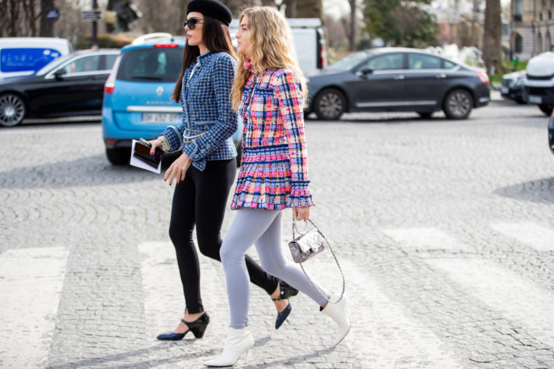 Evangelie Smyrniotaki is seen wearing black beret, blue blazer, black pants and Emili Sindlev wearing checkered jacket, tights outside Chanel during Paris Fashion Week - Womenswear Fall/Winter 2020/2021 : Day Nine on March 03, 2020 in Paris, France