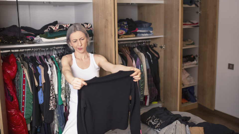 Woman reorganizing her wardrobe