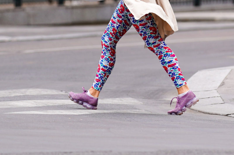 A passerby wears blue and red floral print leggings, purple sneakers shoes, on July 04, 2020 in Paris, France. (Photo by Edward Berthelot/Getty Images)