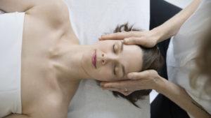 Overhead view serene woman receiving face and scalp massage
