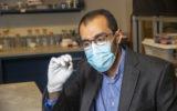 Dr Rahim Rahimi with the capsule