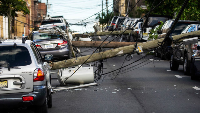 Deaths and power outages as Hurricane Isaias makes US landfall