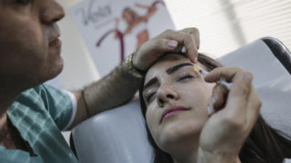 A woman receives a botox injection at a private medical centre in Beirut, Lebanon