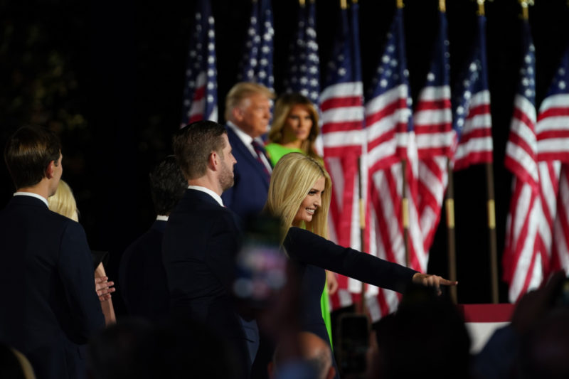 Ivanka Trump gestures to someone in the crowd after introducing her father