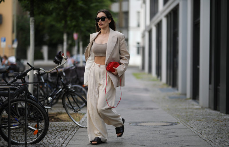Anna Schürrle wearing Bottega Veneta bag and shoes, Balenciaga shades and by Aylin Koenig Suit and Top on June 28, 2020 in Berlin, Germany