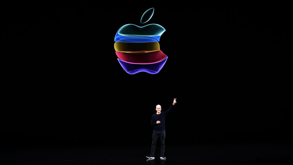 Apple CEO Tim Cook speaks on-stage during a product launch event at Apple's headquarters in Cupertino