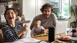 Close up of a young family using a smart speaker while having breakfast in the morning