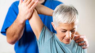 Chiropractor Doing Chiropractic Adjustment Of Female Patient