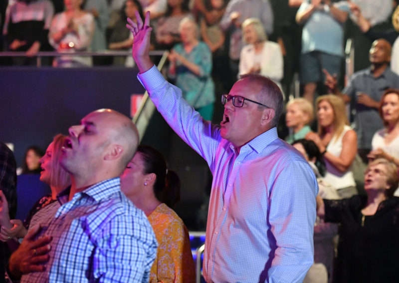 Prime Minister Scott Morrison and wife Jenny sing during an Easter Sunday service at his Horizon Church at Sutherland in Sydney