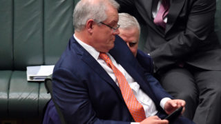 Prime Minister Scott Morrison and Deputy Prime Minister Michael McCormack confer during Question Time in the House of Representatives at Parliament House on June 11, 2020 in Canberra, Australia