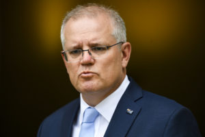 Australian Prime Minister Scott Morrison speaks to the media during a press conference following a national cabinet meeting, at Parliament House in Canberra