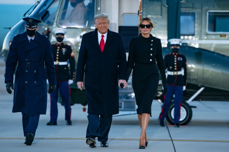 Outgoing US President Donald Trump and First Lady Melania Trump step out of Marine One at Joint Base Andrews in Maryland on January 20, 2021